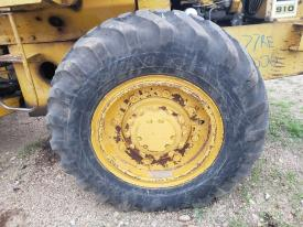 CAT 910 Tire and Rim