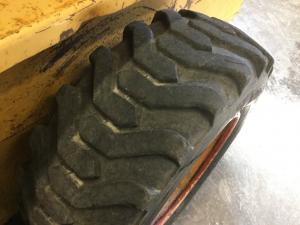 CASE 1845 Tire and Rim