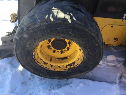 2011 New Holland L218 Tire And Rim: P/N 84369430
